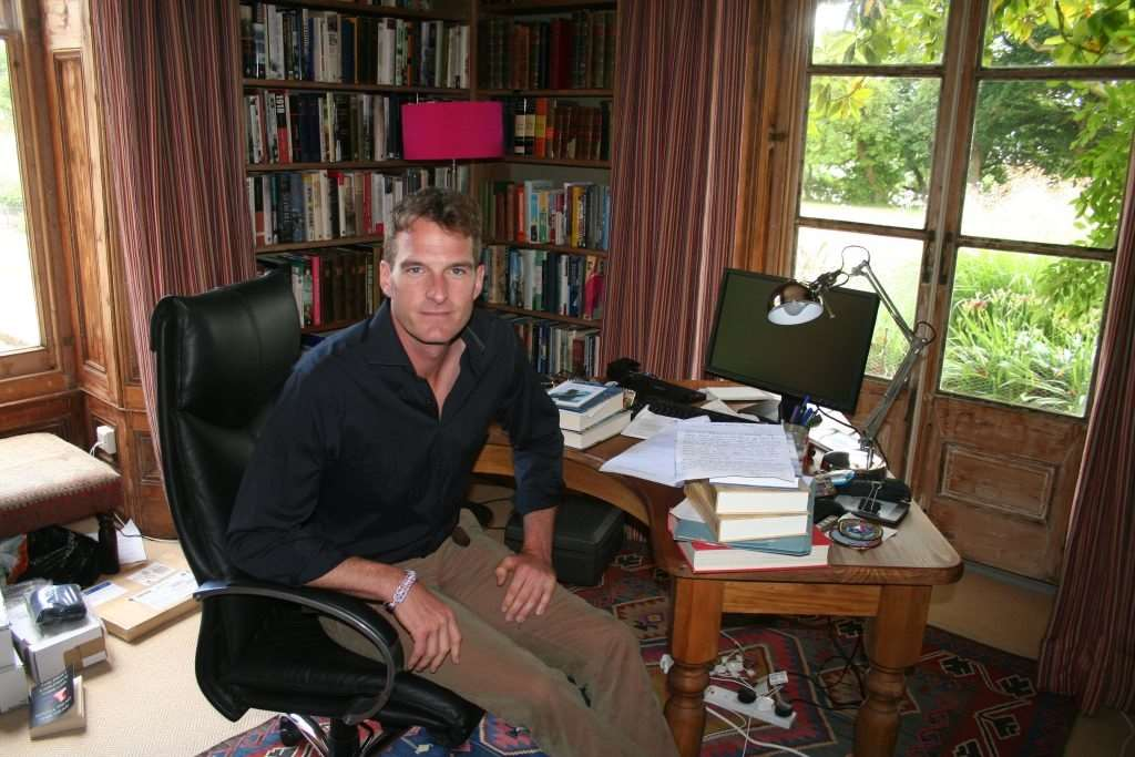Dan Snow in his study which is filled with historical tomes