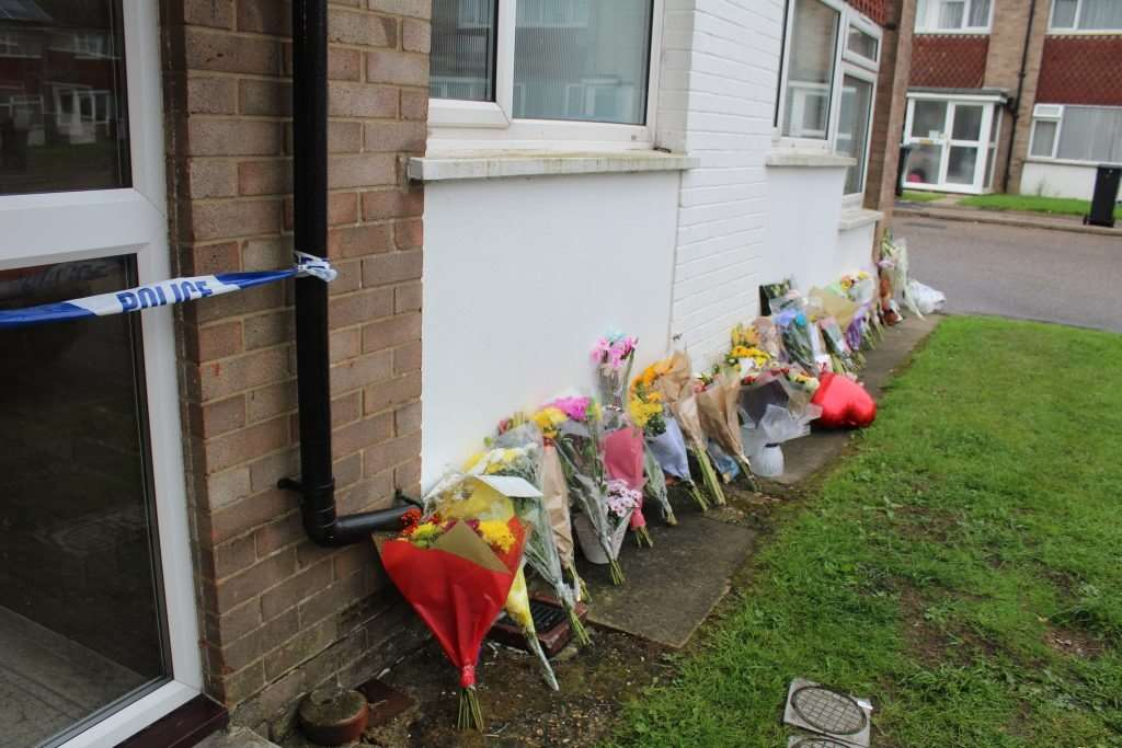 Flowers left outside the block of flats where Sharon's body was found