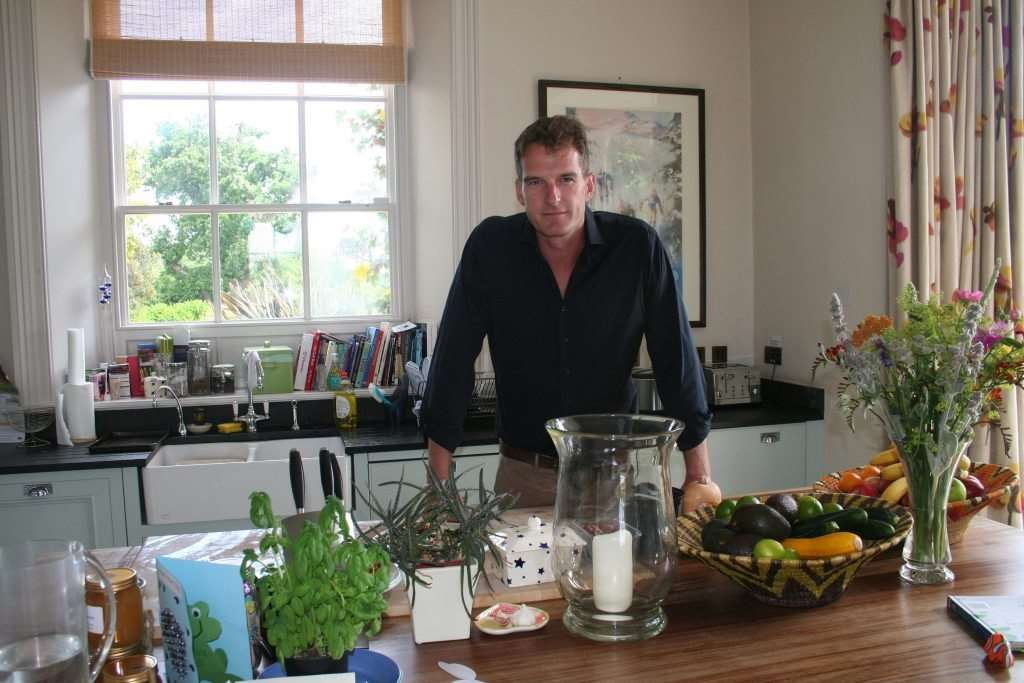 Dan Snow in the kitchen of his home he bought from a former mercenary