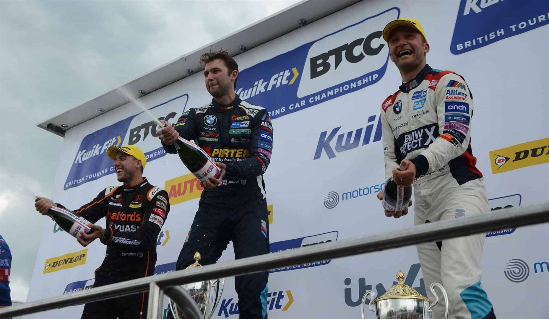 Champagne for touring car stars with Dan Cammish (left), double winner Andrew Jordan (centre) and Colin Turkington