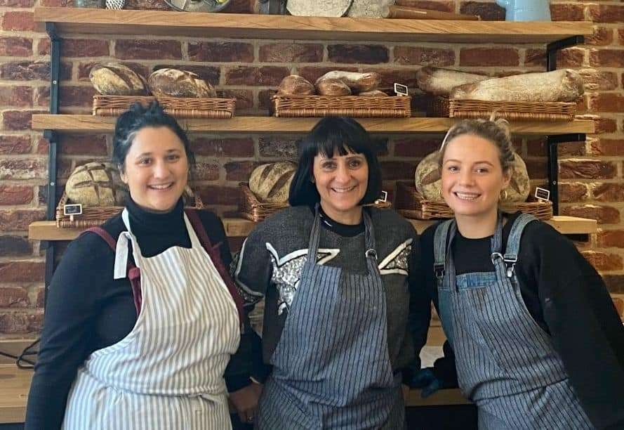 Amanda Maidment, centre, with staff at the Coastal Bakery