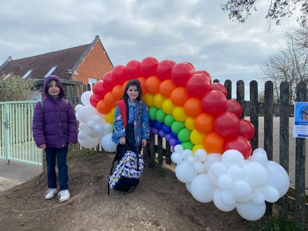 Milford Primary School pupils Frances and Amelie Waters in front of the balloon sculpture